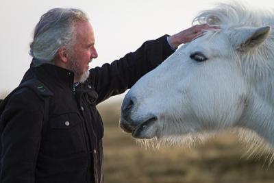 Photo of David patting horse